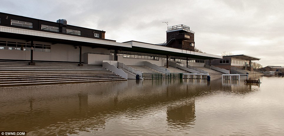 Anyone for a spot of water polo? The River Ouse burst its banks in Huntingdon, Cambridgeshire, affecting the town's racecourse today