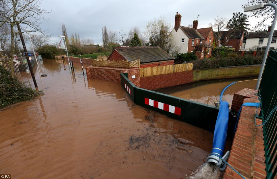 Flood defence barriers that have failed to keep the water out on the outskirts of the town of Upton upon Severn in Worcestershire today