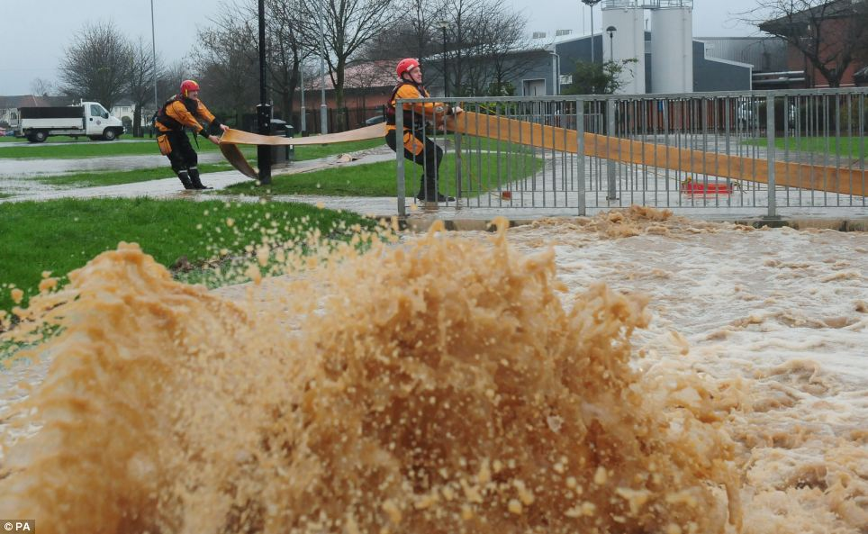 Firefighters used heavy duty pumps to divert water away from Friarage Hospital in North Allerton, North Yorkshire, after a beck turned into a raging torrent