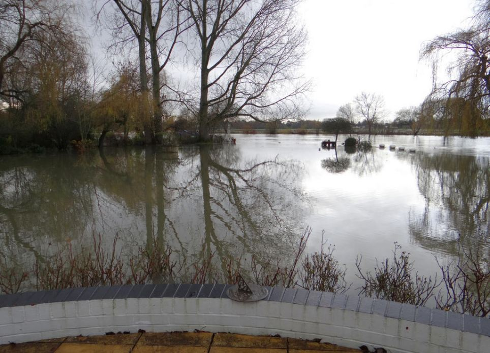 Paul Daniels posted another picture on Twitter showing the flooded fields at his home today, writing: 'The garden this morning. No problems'.