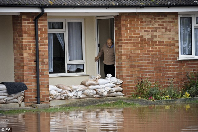 High waters: Insurers have to pay-out around £3billion in claims during extreme flooding and want Government backing going forward