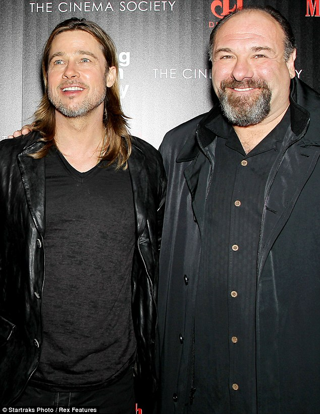 The go-to-guy for gangster: Brad poses with co-star, and Sopranos legend James Gandolfini