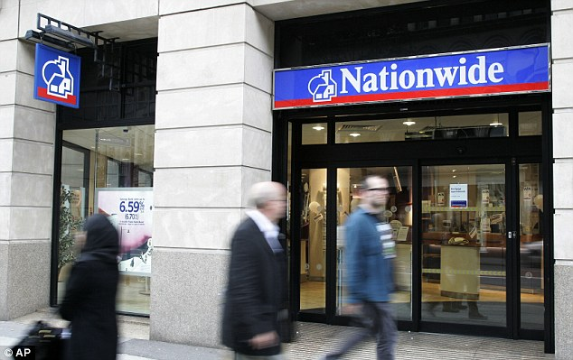 Profits slide: Losses on commercial property loans and derivatives trading and bumped-up compensation payouts to people mis-sold PPI insurance took a chunk out of Nationwide's latest earnings