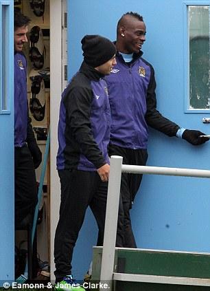 Attacking threat: Mario Balotelli (right) and Sergio Aguero