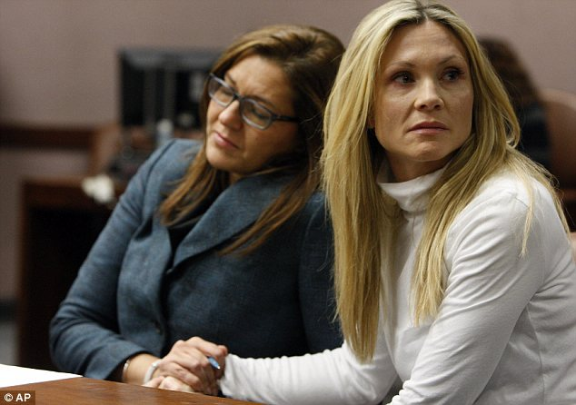Awaiting her fate: Locane-Bovenizer locks hands with her attorney Ellen Torregrossa-O'Connor as they wait for the jury to announce their verdict