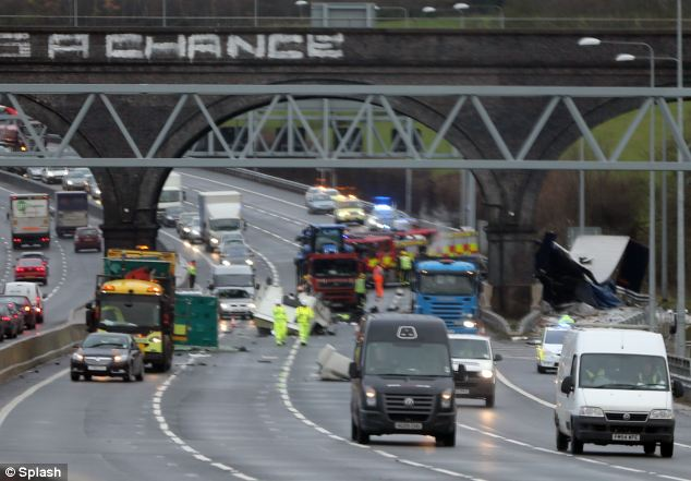Carnage: Emergency services work at the scene of the fatal crash