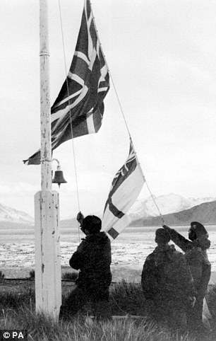 Past invaders: British troops raise the Union Flag and white ensign on South Georgia after they recaptured the island from the Argentineans