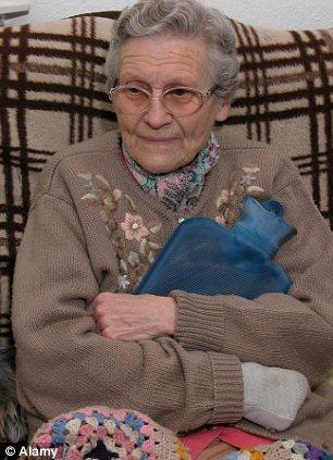 An elderly woman clutching a hot water bottle