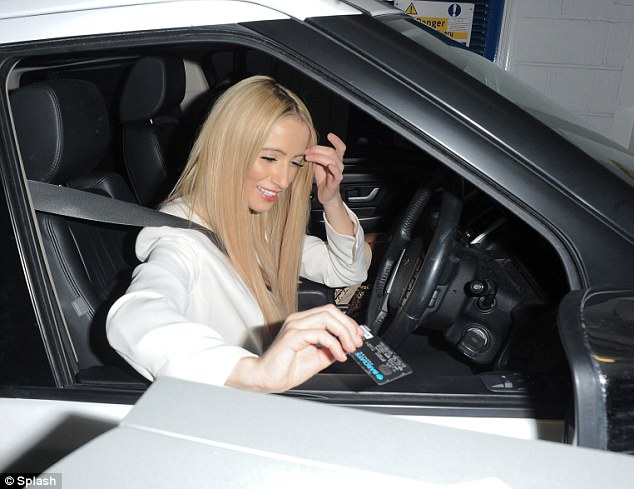 Pay and display: Chantelle was seen pulling up in her own car at the party in which she had to pay for parking