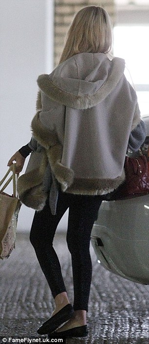 Blonde ambition: The former reality TV star looked superb as she took her baby for a shopping stroll
