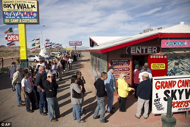 Gold rush: A crowd of people line up outside the Arizona Last Stop convenience store and souvenir shop to buy Powerball tickets before the Wednesday drawing