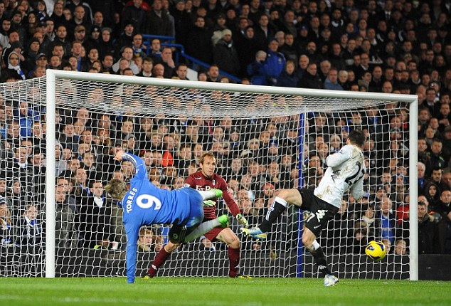 ... but the striker's volley flies harmlessly wide of Mark Schwarzer's goal