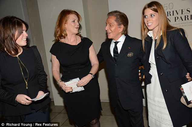 Swapping tips: Sarah, Beatrice and Eugenie were seen chatting away with the Italian designer