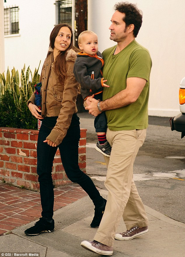 Family man: Jason with son Gus and his on-off girlfriend Danielle Schreiber in December 2011
