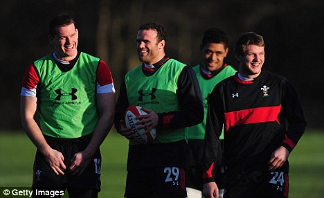 In good spirits: Jamie Roberts (second right) is expected to play after being forced off in the first half against Argentina and New Zealand