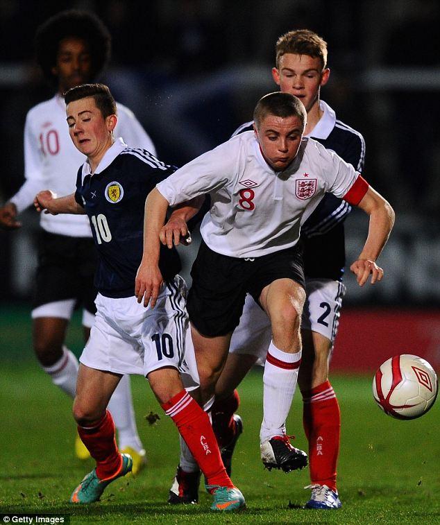 Tussle: Jordan Rossiter of England battles with Steven Boyd and Sam Wardrop of Scotland