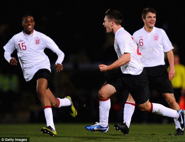 Delight: Rasulo is congratulated on scoring the winning goal