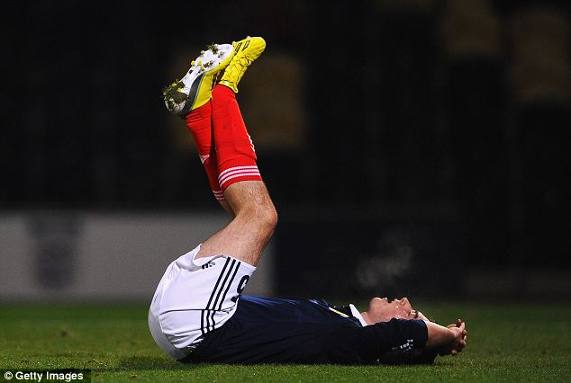 Dejected: Michael Kelly of Scotland shows his disappointment