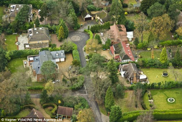 The Coach House, home of Russian supergrass Alexander Perepilichnaya, can be seen at the top left of this picture of millionaires' luxury private estate, St George's Hill, in Weybridge, Surrey