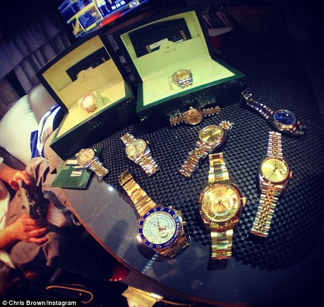 What a stash: Chris posts a picture of a collection of Rolex's, sparking rumours that he bought Rihanna's for her