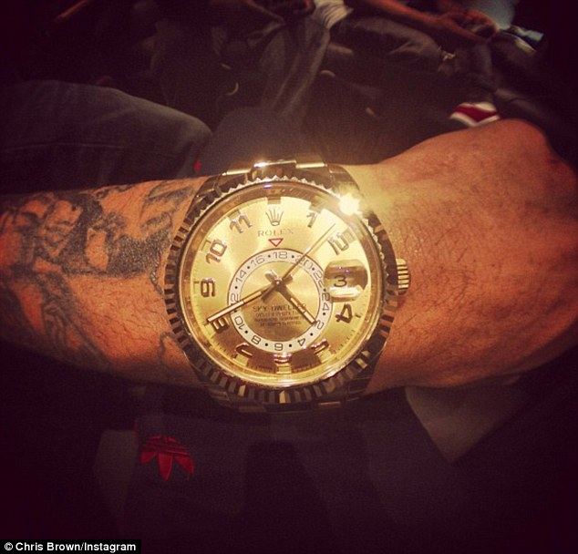 Flashing the gold: Chris also posts a picture of himself wearing a Rolex