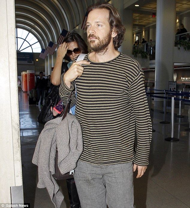 Forbidden love: Peter Sarsgaard, pictured here last month with wife and fellow actress Maggie Gyllenhaal walking through through Los Angeles Airport with their daughter Gloria Ray, plays a bomb experts who embarks on a relationship with Dakota's character