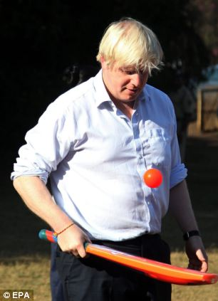 London Mayor Boris Johnson plays with the underprivileged children from the Mumbai based Magic Bus NGO, in Mumbai, India, 29 November 2012. Boris Johnson is on a five-day visit to India