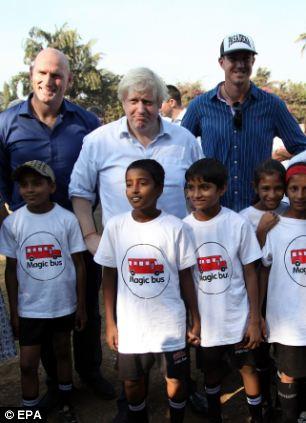 Boris Johnson, centre, with Kevin Pieterson, right, and Lawrence Dallaglio, left