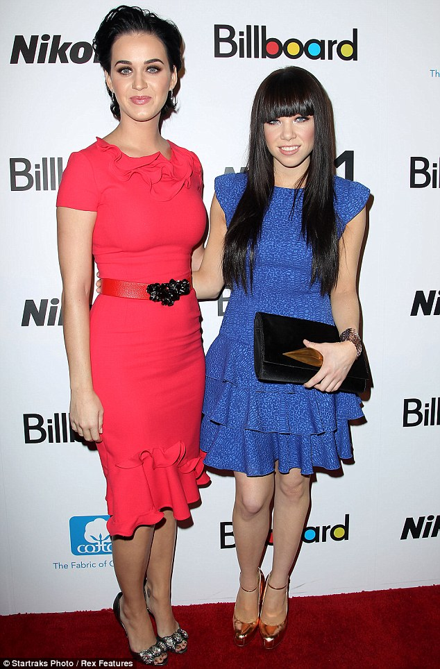Pop art: Katy Perry and Carly Rae Jepsen looked fabulous in hot pink and true blue at Billboard's Women in Music, New York on Friday