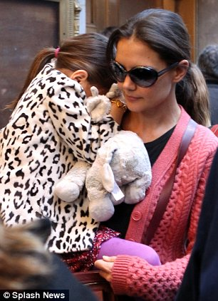 Firm favourite: Suri has often been spotted out in the Big Apple with the well-loved toy