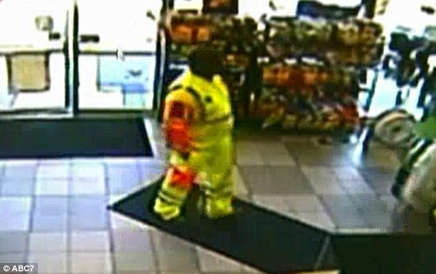 Winner? Surveillance footage from a Maryland gas station shows a construction or highway worker