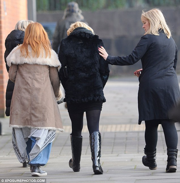Comfort: The actress was comforted by her companion during a break from filming Coronation Street