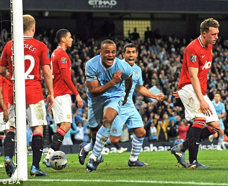 Leading by example: Vincent Kompany celebrates scoring against Manchester United
