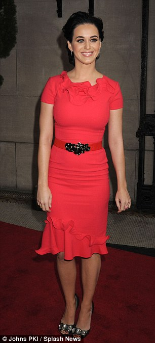 So confidant: Katy's dress fit her shapely figure perfectly