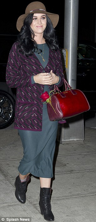 Dressed down: Katy later in the day arrived to catch a flight at JFK airport in New York City