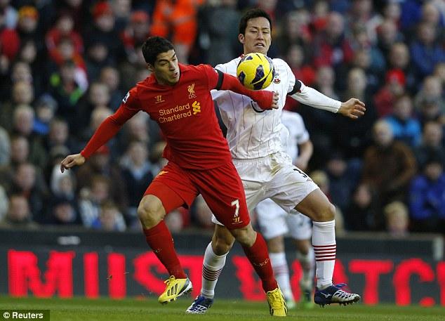 Combative: Luis Suarez eases away from Maya Yoshida (above) as Lucas tackles Gaston Ramirez (below)