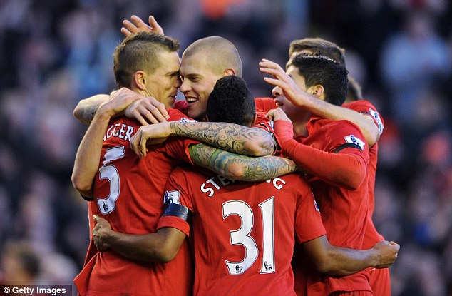 Winning moment: Daniel Agger rises highest to meet Glen Johnson's cross to spark celebration from the Liverpool players (below)