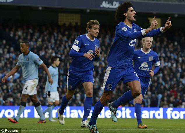 Out in front: Marouane Fellaini celebrates yet another goal