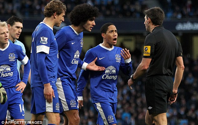 Having words: Everton players protest against the penalty award