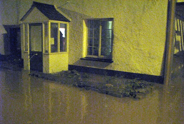 Deluge:  Phil and Sally White's home after the floodwaters rose