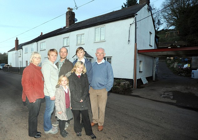 Awash: The White family, from left, Anne, Sally, Phil, Leah and Cyril. Front: Emily and Charlotte