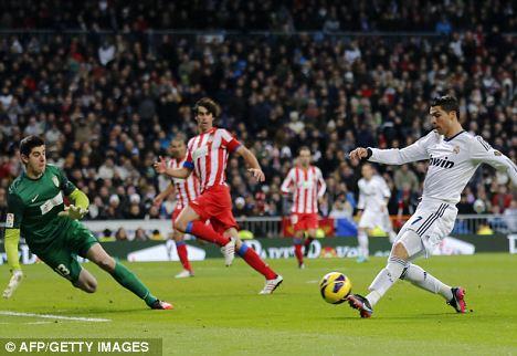 Close call: Ronaldo saw this effort hit the post