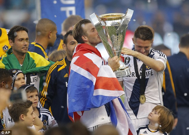 Glory boys: Beckham and Robbie Keane lift the MLS Cup