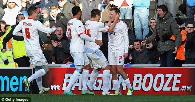 Happy days: Gleeson celebrates with his team-mates after scoring the first goal