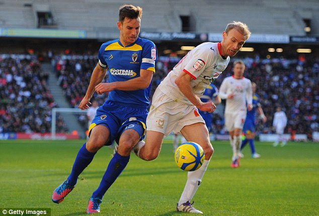 Battle: Luke Chadwick (right) and Steve Gregory fight for possession at stadium:mk