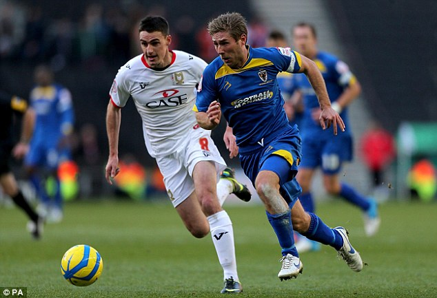On the run: AFC Wimbledon's Stacy Long (right) sets up another attack for the visitors