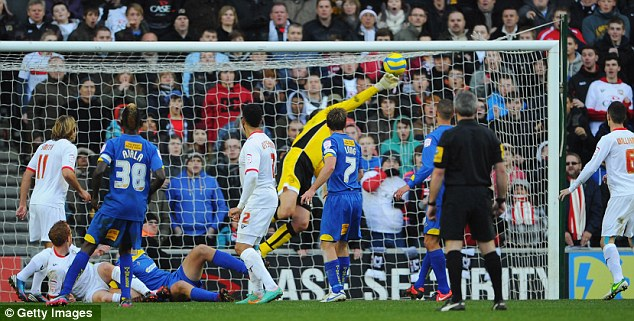 Stranded: Jon Otsemobor flicked home the winner for MK Dons in the dying minutes