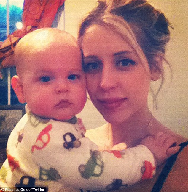 Happier: The seven-month-old quickly dried his tears and cosied up to his famous mother in a Twitter snap