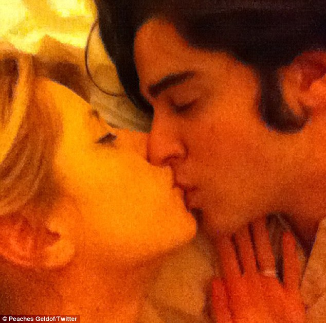 Avid sharer: Peaches and Tom cuddle up in another one of her Twitter pictures