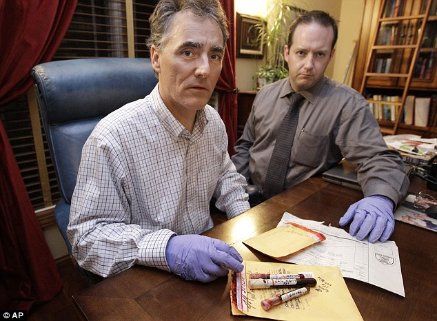 Cook County Sheriff Tom Dart, left, and sheriff's detective Jason Moran, pictured with John Wayne Gacy's blood, which may help solve 'the coldest of cold' cases